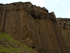 The waterfall of Litlanesfoss is beautifully framed by basalt columns such as these