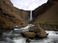 The gorgeous Hengifoss waterfall (Iceland's 3rd highest). This waterfall is unique because of the basaltic strata interspersed with red clay sandwiched between its layers
