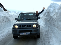 Robby stops for a wave along a snowy section of our journey to Askja