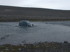Our trusty Suzuki Jimny crossing the F905 river. If the river were any higher, we wouldn't attempt a crossing. As it was, poor Becky had to wade through first to scout out the best path for our Jimny to follow