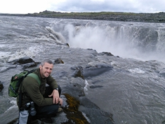 Another view of Robby next to his favorite waterfall of our entire trip, the impressive Selfoss