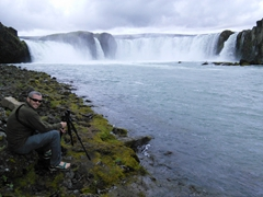 Robby setting up the tripod for a motion blur shot;  Goðafoss