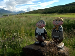 Garden figurines made of stones. The female is wearing Iceland's national costume while the male dons an Icelandic woolen sweater (lopapeysa)