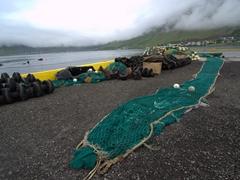 Fish nets and gear laid out behind the maritime museum; Ísafjörður