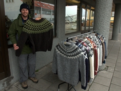 Robby hold up a popular souvenir. Lopapeysa (Icelandic sweaters) are surpringly popular with the locals who wear them not only for warmth but also as a fashion statement