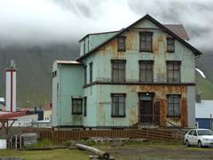 Weather beaten, corrugated steel building in Ísafjörður