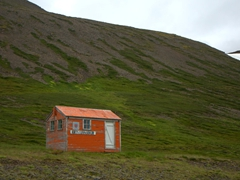 Emergency huts (painted bright orange) can be seen throughout Iceland, especially on remote mountain tops