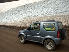 Robby behind the wheel of our Jimny (notice how high the snow is stacked next to us? And yes, we visited in the middle of summer)