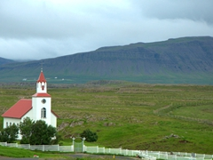 """View overlooking a church from Helgafell (""""holy mountain"""")"""