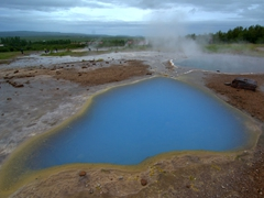 View of the blue pool of Blesi. This hot spring is deep blue in color due to colloidal silica, and its temperature is around 45° C