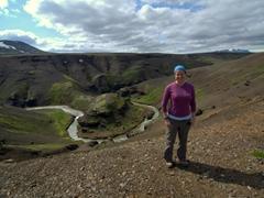 Becky next to a horseshoe-shaped canyon; Kerlingarfjöll