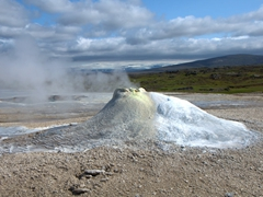 "Hveravellir (""hot spring fields"") is a popular stopover on the Kjölur Route. This is a fumarole called Oskurholshver (""screaming spring"") which earns its name from a constant jet of whistling steam pouring from its spout"
