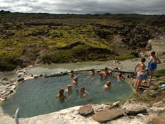Bathers crowd into the man made pool at Hveravellir