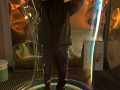 Robby stands inside a massive bubble; Reykjavik Zoo