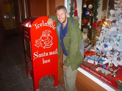 Robby leans up against Santa's mailbox after one too many drinks; Reykjavik rúntur