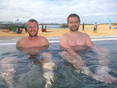 Robby and Daniel soak in a hot pool at Nauthólsvík Geothermal Beach