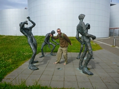 "Robby joins ""The Band"" (by artist Þorbjörg), a group of statues outside Perlan (""the pearl""); Reykjavik"
