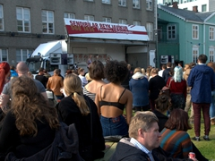 "A crowd gathers on the Austurvöllur square to partake in the annual ""Drusluganga"" (slut walk) event, which combats victim blaming or slut shaming of rape victims; Reykjavik"
