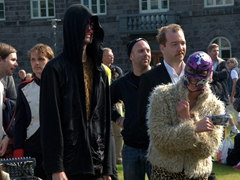 "Wrestling masked spectators at the ""Drusluganga""  rally; Reykjavik"