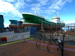 Boats undergoing maintenance; Reykjavik Harbor. Check out the unique bike rack in the foreground