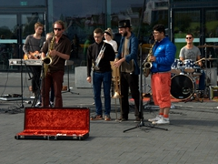 "Members of Icelandic band ""White Signal"" putting on a show for the crowd; outside of Harpa Hall"