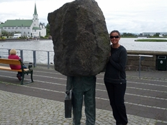 Becky poses next to an interesting statue outside City Hall; Reykjavik