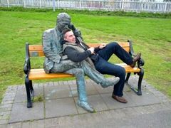 This friendly local happily posed for us relaxing in the statue's lap; Lake Tjörnin
