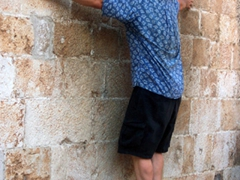 Bob accomplishing the impossible, balancing precariously on a Dubrovnik church indent