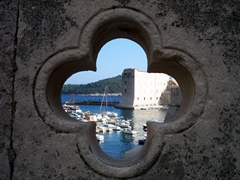 View of Dubrovnik looking through a clover shaped window