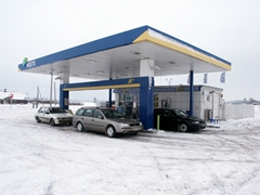 Snow engulfed gas station, somewhere between Tallinn and Tartu