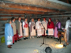 Women in traditional dresses singing Estonian songs; Rocca al Mare Estonian Open Air Museum