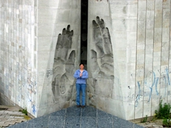 "Becky standing in middle of the ""hands"" monument, a large concrete monument just outside of Tallinn"