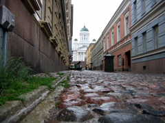 Cobblestoned streets serve pedestrians and motorists alike in old Helsinki