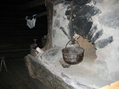 A warm fireplace where hot meals are prepared; Seurasaari Open Air Museum