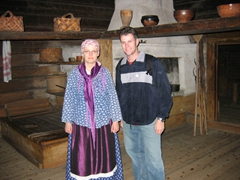 A Finnish guide dressed in traditional costume poses with Robby at the Seurasaari Open Air Museum