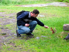 Robby feeding a tame squirrel, Helsinki open air museum
