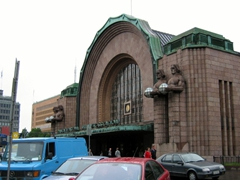 Helsinki's train station (notice the huge statues holding globes standing adjacent to the main entrance)