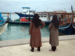 Despite the sweltering heat, Maldivian women are covered from head to toe in conservative Maldives; Dhigurah Island
