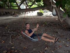 Robby hops on a typical Maldivian swing; Dhigurah Island