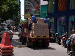 Transporting goods through crowded Malé
