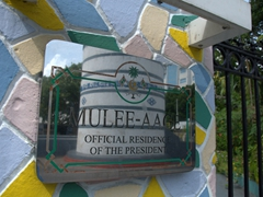Signpost for Mulee Aage Presidential Palace (with the old mosque minaret tower in its reflection); Malé