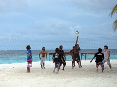 Playing a game of volleyball on Raidhiga Island
