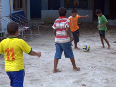 Boys enjoying a game of soccer; Dhigurah Island