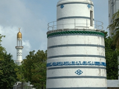 View of the blue/white striped minaret (munnaaru) overlooking the 1656 coral built mosque of Hukuru Miskiiy; Malé
