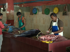 Fishmongers ply their trade at the Malé fish market