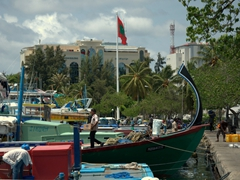 Dhonis along the waterfront in Malé