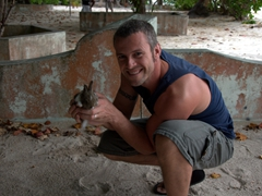 Robby holds up a baby rabbit (someone's future meal) on the island of Dhigurah