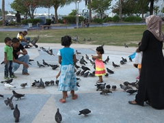 Feeding pigeons at the Jumhooree Maidan (Main Square) of Male