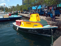 Colorful boat in the fishing harbor; Male