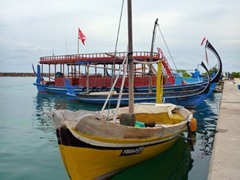 Colorful dhonis in the harbor of Dhigurah Island
